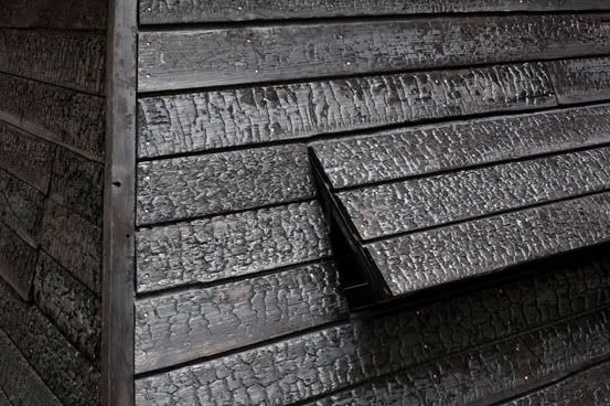 Charred wood siding-fire resistant, insulation, bug and rot resistant, and beautiful!