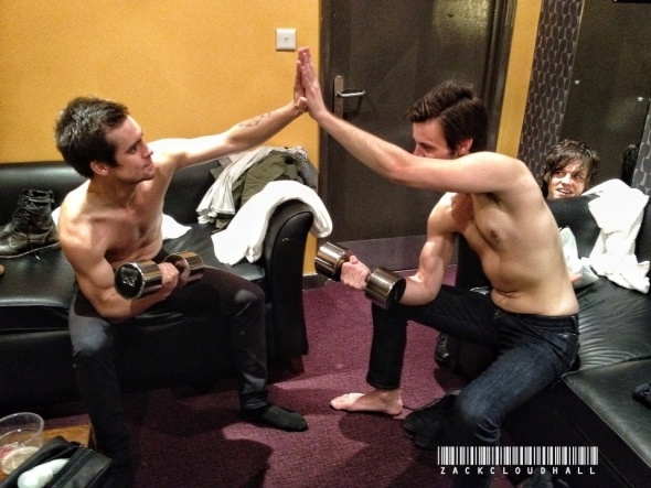 Brendon Urie and Spencer Smith. LOOK AT DALLON'S FACE BEHIND SPENCER