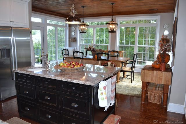 I LOVE this sunroom as a dining room off the kitchen.  This would be ideal for our kitchen and porch enclosure.