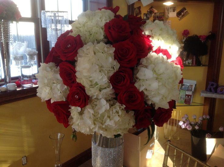 42 best wedding decor red white images on pinterest red roses wedding centerpiece of white hydrangea and red roses with diamond pins atop a diamond banded cylinder junglespirit Gallery