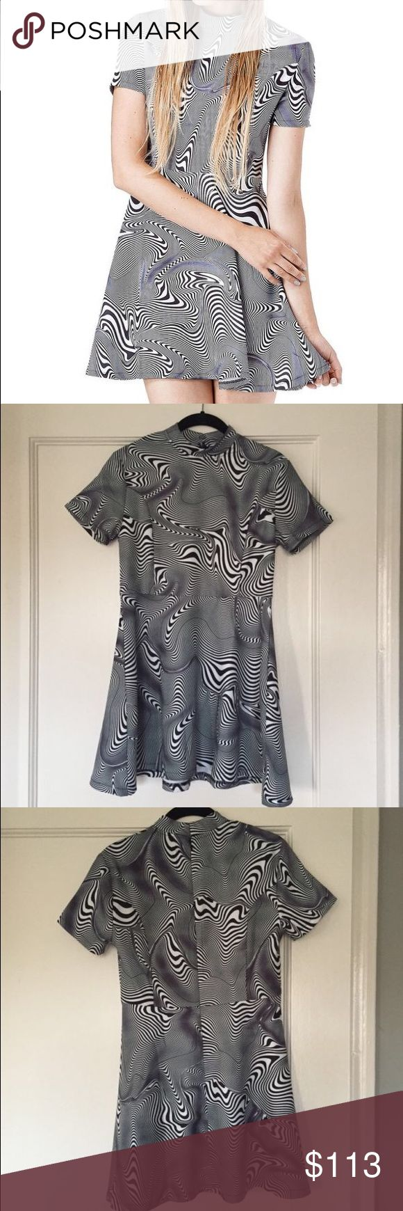 MEGA RARE Unif Cid Dress SUPER RARE NWT Unif Cid Mini Dress. Size medium but can fit small as well. Crafted in a trippy, optical print for an offbeat vibe; featuring a high neck and short sleeves. This dress is a must-have for any bad babe! Asking $90 OBO on depop or 🅿️🅿️ lyk omighty aa Brandy uo urban American outfitters apparel Dollskill lazy oaf grunge rave asos topshop 💕I JUST WANNA SELL SO I HAVE MONEY FOR MY BDAY IN A WEEK SO FEEL FREE TO MAKE OFFERS💕 UNIF Dresses Mini