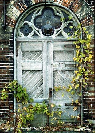 love old doors with chevron design--quatrefoil stained glass is the best part!