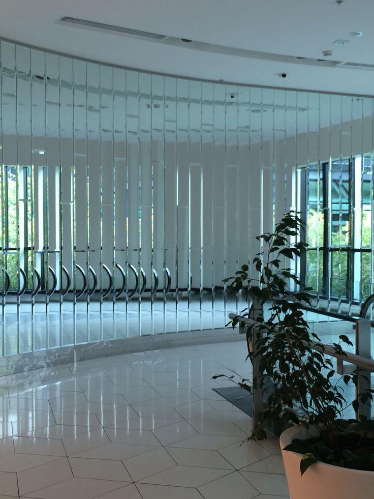 Mirror panels along a wall near escalators at Crown Casino