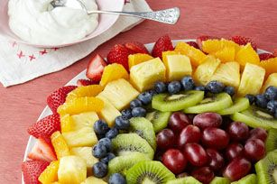 Sunburst Fruit Salad recipe - Drizzled with a creamy honey-citrus sauce, our artfully arranged fruit salad almost looks too pretty to eat. (Almost.)