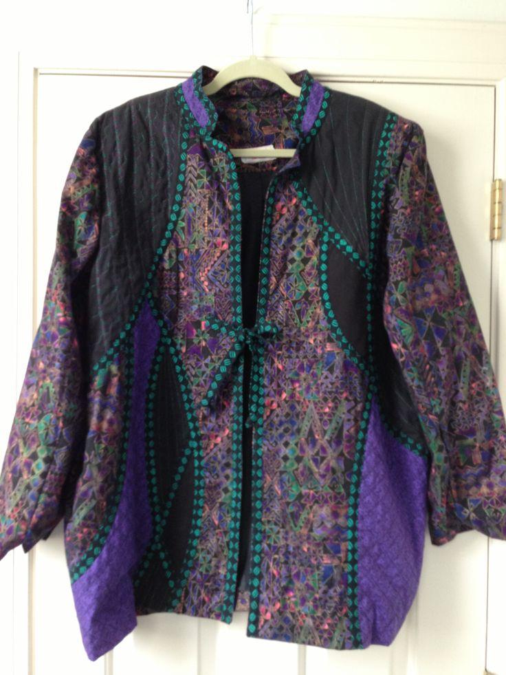 Batik jacket with decorative metallic stitching.