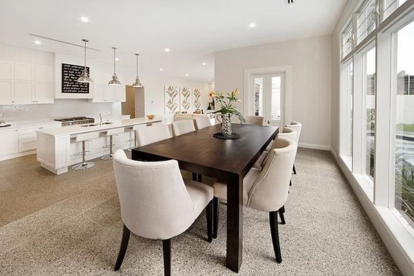 modern open plan living room kitchen dining area white kicthen cabinets terrazzo floor