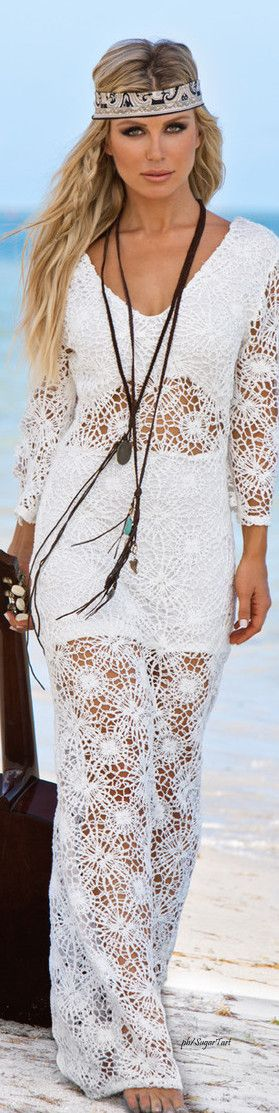 Beautiful white crochet long dress. Model with headband on standing on the beach. Hippie Boho gypsy fashion