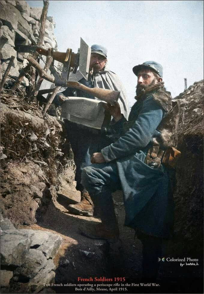 Two French soldiers operating a telescope rifle in a trench at Bois d'Ailly, Meuse. April 1915  The 56° Infantry Regiment amongst others, held the front at Bois d'Ailly on the Meuse in early April 1915. Nine months after the start of the war, April 5, the French army launched an offensive on the Moselle and the Meuse.  (Colorized by Irootoko jr from Japan)