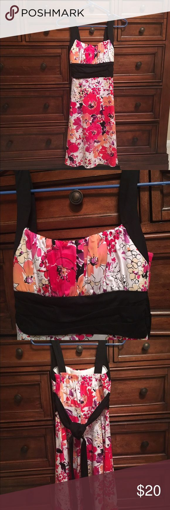 Cute flower dress Super cute, fun flowery dress. Bright pink and orange flowers with black straps and waste band. Can knit or bow tie in back of dress. Has zipper in back of dress, also has elastic in top of back of dress. Worn only once for Easter dinner. B Smart Dresses Midi