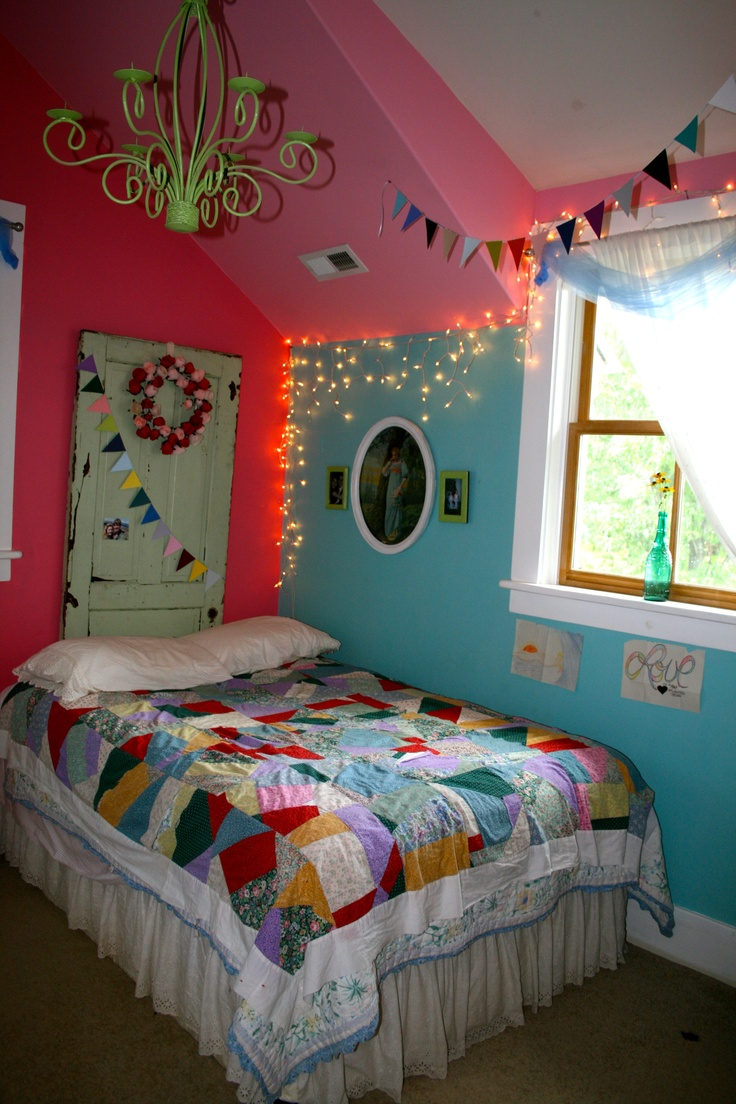 my room(: spray painted old chandelier-thrift shop find, crazy quilt my mom and i made when i was little, three different color walls, drawings by my boyfriend(:, paint chip bunting, old antique door found in dilapidated house years ago, and christmas lights(: #boho #hippie #chic #colorful