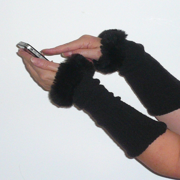 Cosy black arm warmers with faux fur edge from elastic boucle wool mixture, size S/M. $24.00, via Etsy.