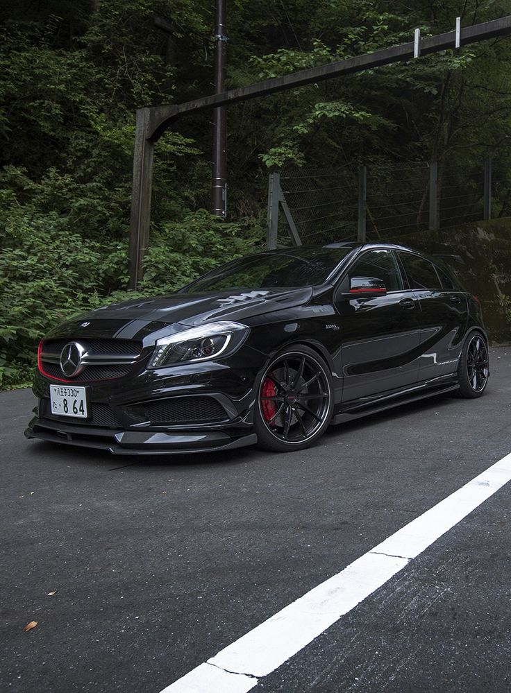 Mercedes A45 AMG painted black with red accents. #RePin by AT Social Media Marketing - Pinterest Marketing Specialists ATSocialMedia.co.uk