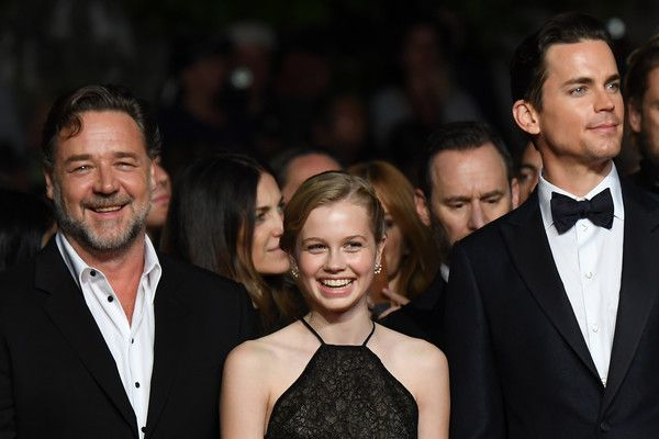 """Russell Crowe Photos - New Zealander actor Russell Crowe, Australian actress Angourie Rice and US actor Matt Bomer arrives on May 15, 2016 for the screening of the film """"The Nice Guys"""" at the 69th Cannes Film Festival in Cannes, southern France.  / AFP / ANNE-CHRISTINE POUJOULAT - 'The Nice Guys' - Red Carpet Arrivals - The 69th Annual Cannes Film Festival"""