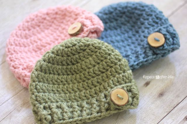 Repeat Crafter Me: DIY Wood Buttons on crocheted baby hats... link to free pattern