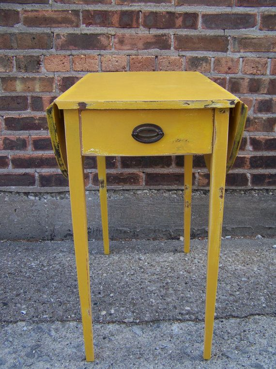 Love the mustard yellow color of this table.