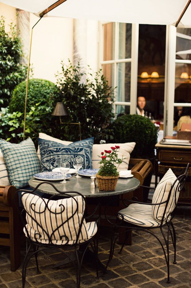 Great blue & white fabric on these pillows - Ralph's in Paris. #patio #textiles by j beck