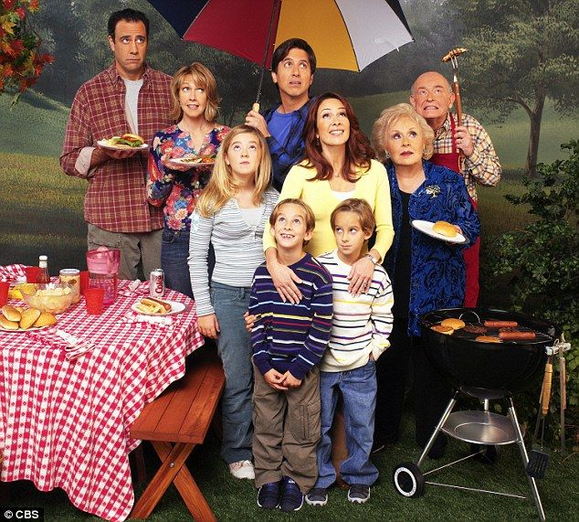 Pictured front left: Sawyer Sweeten stands alongside the Everybody Loves Raymond cast (L-R - Brad Garrett, Monica Horan, Madlyn Sweeten, Sawyer Sweeten, Sullivan Sweeten, Ray Romano, Patricia Heaton, Doris Roberts, Peter Boyle)