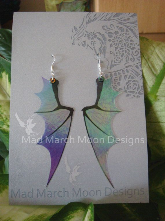Dragon wing earrings made from light weight acetate layers they are iridescent and transparent and have a rainbow shimmer.  The design comes in 8