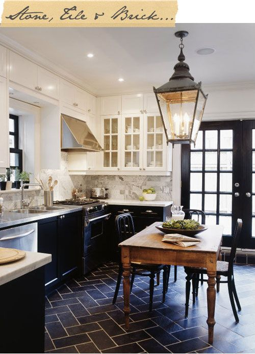 kind of a gorgeous kitchen, love the dark flooring and black cabinetry with the white and the rustic woods. So ooh la la.Kitchens Design, Lights Fixtures, Floors, Black Doors, Black And White, Black Cabinets, Black White, White Cabinets, White Kitchens