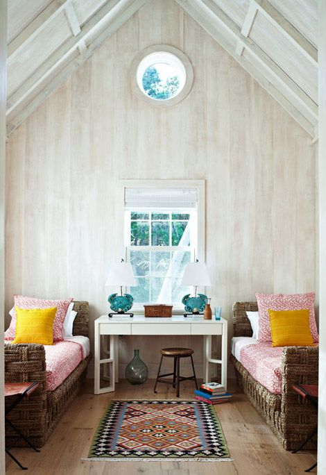 Bedtime in a summer home - bliss! Eaves and bleached wood walls. Interior design by Maureen Footer.