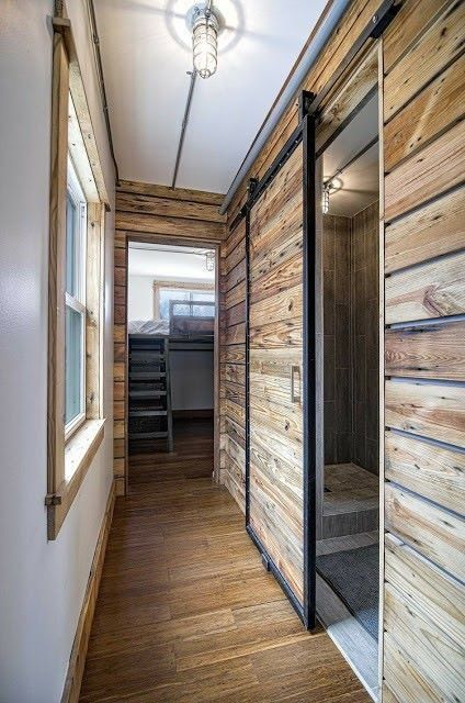The Freedom tiny house from Minimalist Homes, LLC. A 300 sq ft shipping  container home with a sleek, modern interior.