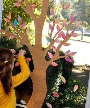 Autumn Window Display - Colorful painted leaves, made from coffee filters. Would be a perfect project for our sliding glass door. A great project for preschoolers and up!