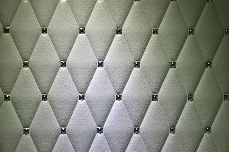 White leather effect diamond shaped wall ceramics with chrome stud insert. Perfect for feature wall in bathroom