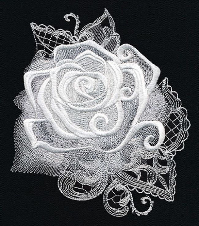 White delicate embroidered roses on black cotton fabric