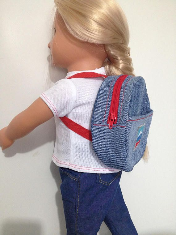 Backpack made from upcycled denim with postage stamp applique