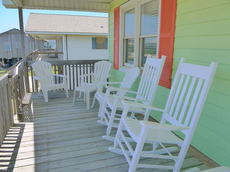 Vitamin Sea  Colorful Siding And Shutters With Welcoming Rocking Chairs  Http://www