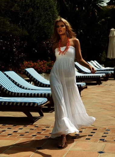 Cotton Anglais sweeping maxi dress with shirred top and softly flared bottom panel.