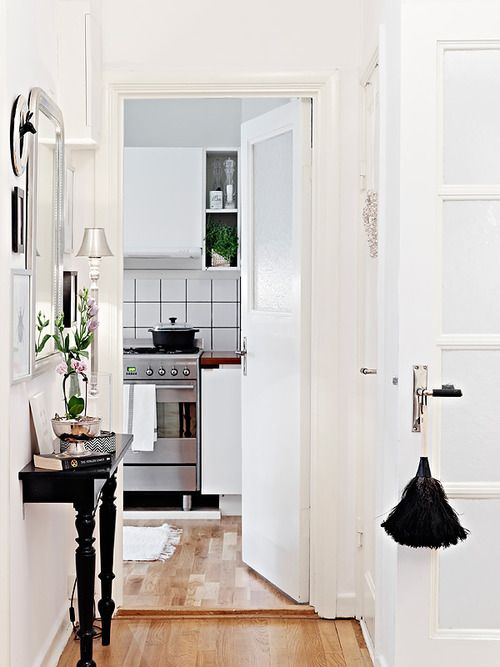 White walls can open up any small space. BUT the half entrance table is great for slim hallways.