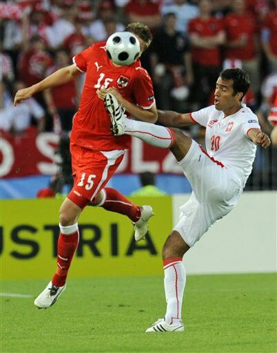 Austria 1 Poland 1 in 2008 in Vienna. Roger Guerreiro goes high with the foot on Sebastian Prodl in Group B at Euro 2008.
