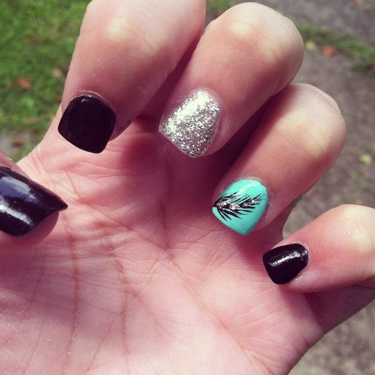 Feather nails. Absolutely lovee this!!! maybe something besides black though