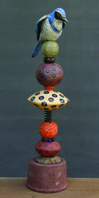 Totem sculpture with bird