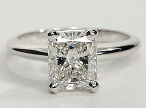 18k white gold with a four-prong design, 2.05 radiant-cut diamond with perfectly elongated proportions.. Simple and heirloom worthy,  definitely a dream ring.. a skinnier band would highlight the diamond even more.... If we are married for at least 55 years, this ring would cost less than $0.84 per day.