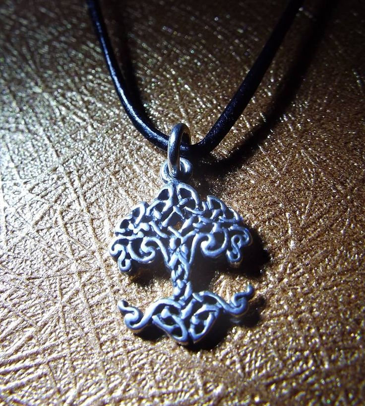Handmade sterling 925 silver tree of life pendant with Celtic patterns.