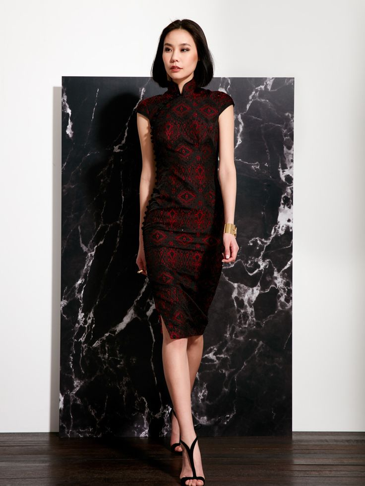 Cut from rich red jacquard fabric, this chic longer length qipao perfectly balances nomadic bohemian feel with couture sophistication. It is an elevated version of one of our seasonal designs, and is tastefully embellished with crystals and finished with the finest attention to detail. The textured jacquard is a modern take on the distinctive textiles created using the Ikat dyeing and weaving technique.  This exquisite qipao is a limited edition, and is available in less than 10 pieces…