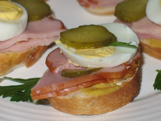 Polish open faced sandwiches, called Kanapki. Rye bread, mustard, ham or sliced smoked sausage, hard boiled egg, and topped off with a pickle. SO good!