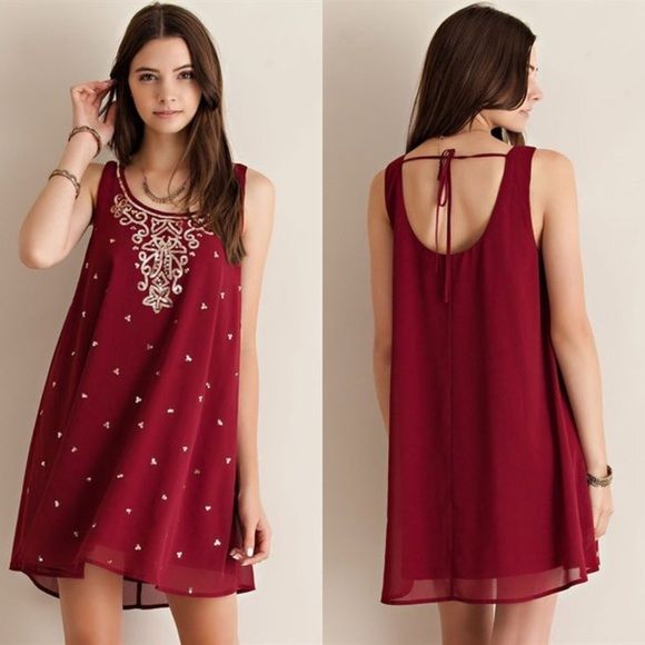 NWT Solid Sequenced Dress ➡️ New from manufacturer ➡️ Color: Wine ➡️ Mini Dress ➡️ Relaxed fit through body ➡️ Gold sequins on front Umgee Dresses Mini