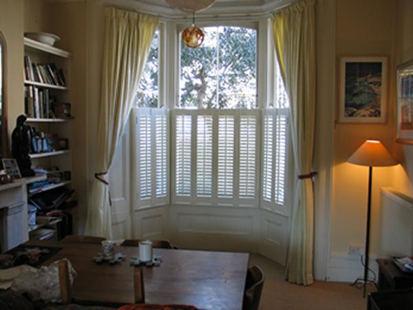 Image from http://www.changingcurtains.co.uk/images/curtains/curtains%20on%20tracks/bay%20shutters%20for%20privacy%20L.jpg.