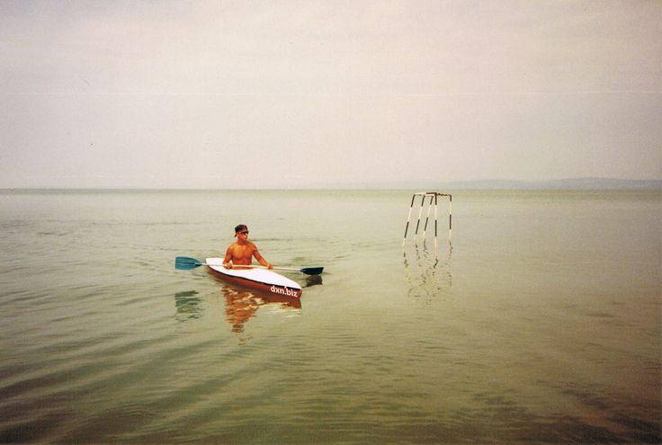 This is me kayaking at Lake Balaton, Hungary in 1995. My parents and I spent many wonderful summers at this beautiful lake. Balatin is one of the landmarks of Hungary. My goal is to move there to a house with garden with my dogs.
