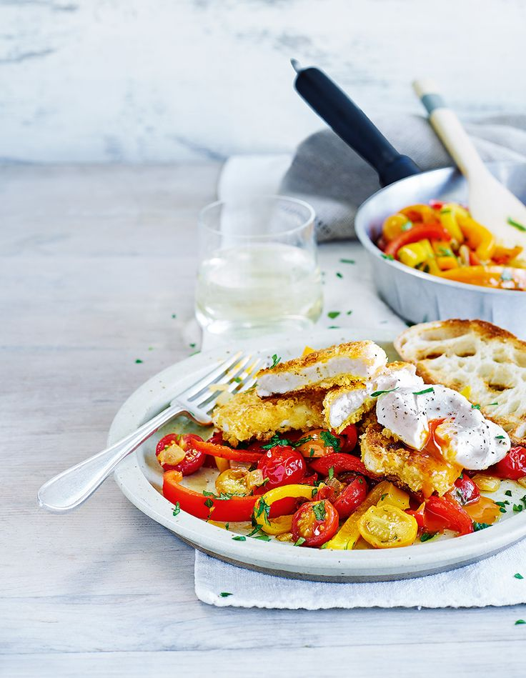 Runny poached eggs, crispy halloumi and sweet cherry tomatoes combine for a breakfast worth getting out of bed for.