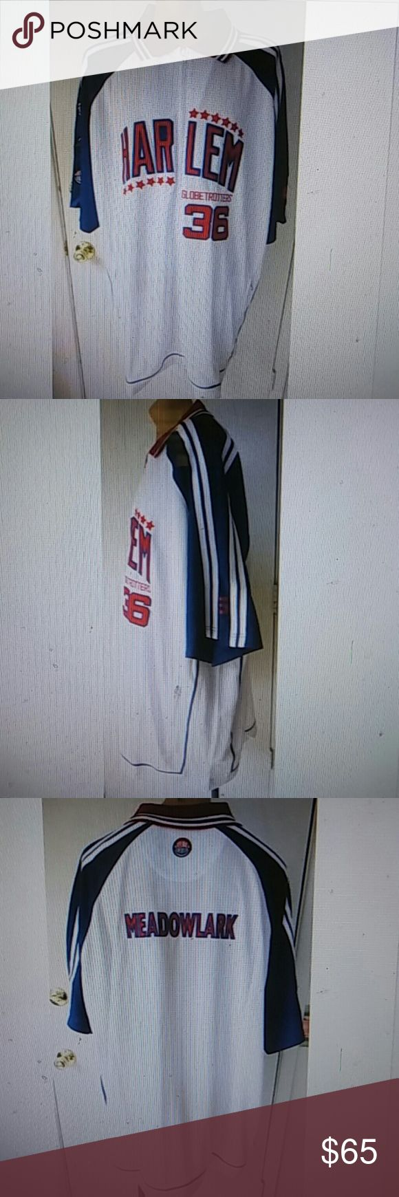 """FUBU PLATINUM -HARLEM GLOBETROTTERS Jacket 4X This listing is for a FUBU PLATINUM men's HARLEM GLOBETROTTERS """"MEADOWLARK LEMON"""" Jersey Jacket. Made of 100% Polyester fabric. Front full zip closure, collar, 2 hip pockets with zip closures, and short sleeves. It is NEW WITHOUT TAGS and is in MINT wearable condition.   Size 4X. Measurements are Length 37"""", Chest 62"""", Waist 62"""", Hip 62"""", Shoulders 29"""", and Short Sleeves 11"""". FUBU Platinum Jackets & Coats Performance Jackets"""