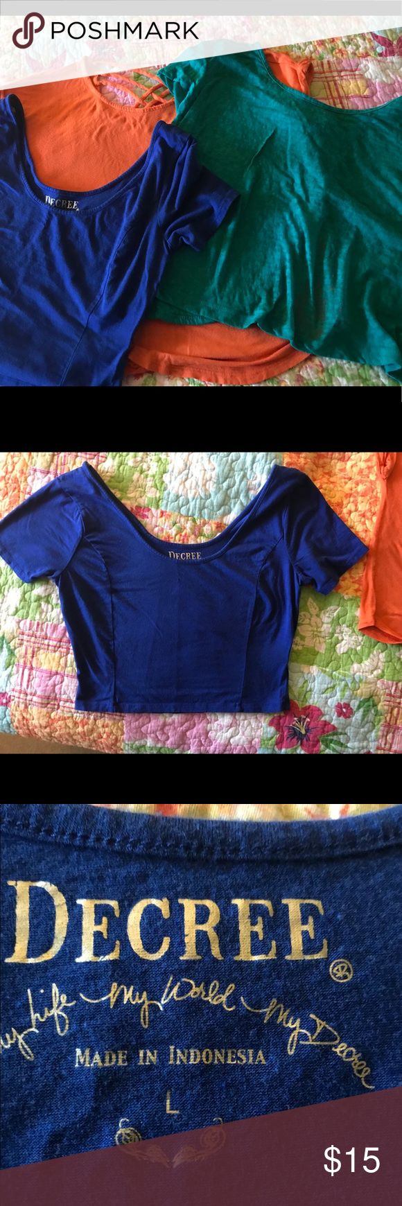 Woman's Crop Top Bundle. Bundle of 3 tops. All size large. -One royal blue Decree cotton crop -One green Nollie crop with with open swing back. -One orange shirt with crisscrossed opening in back. Tops Crop Tops