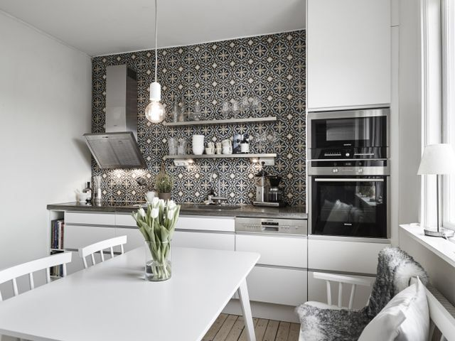 Black and white kitchen & dining room with bench.