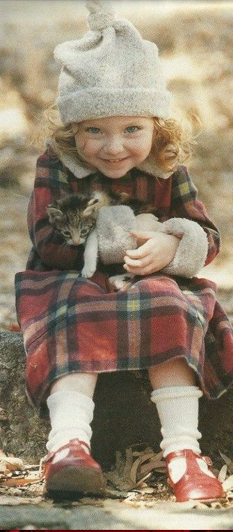 happiness- i chose this picture because i like that it has a little vintage look and its outdoors, i also love how the child is holding a cat because i love animals.