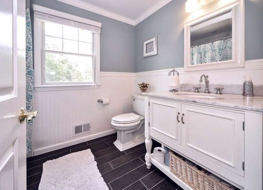 Beautiful white and pastel bathroom with crisp, clean wainscoting