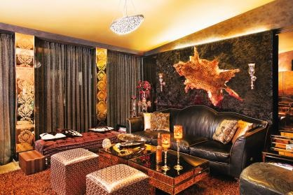 The den is the extention of the formal living room and looks out to the sea. Used during casual gatherings, this space has a special bar panel painting designed by Roberto Ferrari. A faux leopord skin on one of the walls is back-lit and adds a glow to the textured wall.