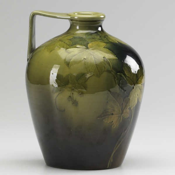 MATT DALY  ROOKWOOD  Standard glaze pitcher with raspberry vine, 20th c.